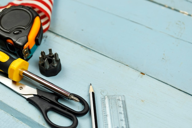 American flag and construction tools on blue wooden