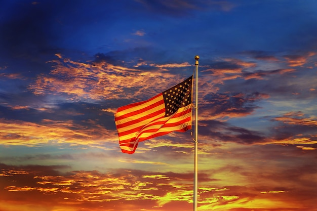 American flag in front of bright sky night sunset red sky