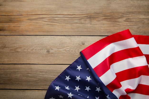 American flag on grey wooden background with copy space