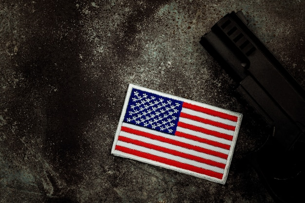 American flag and a handgun