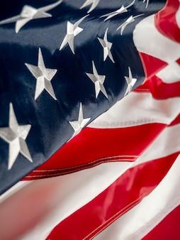Американский флаг сша. день независимости 4 июля, день памяти, день ветеранов, день труда. размытие