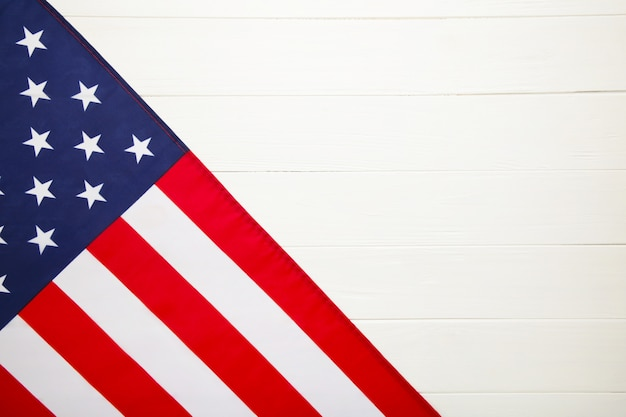 American flag on white wooden background with copy space
