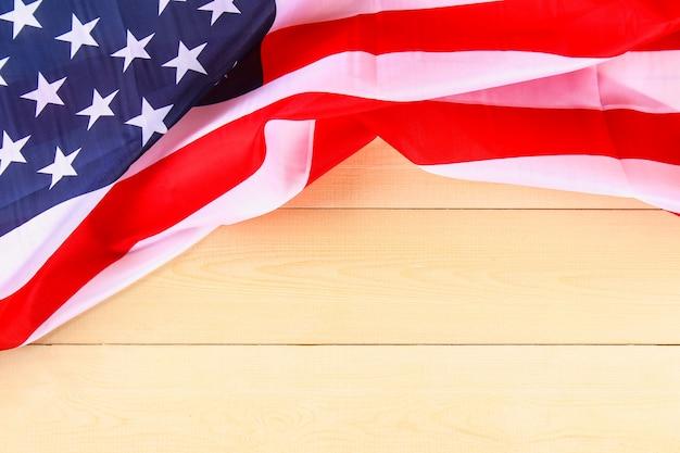 American flag over whitewashed wood background for united states holidays.
