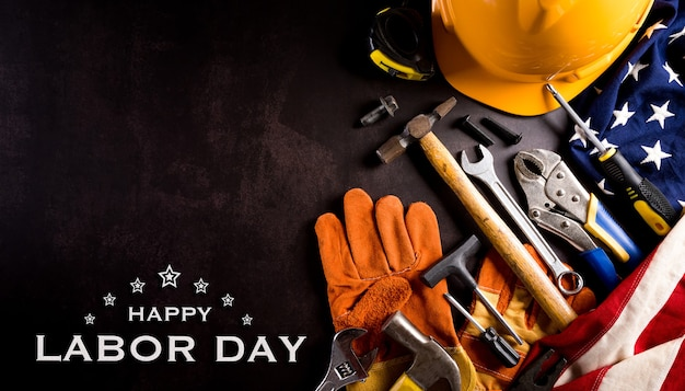 American flag with different construction tools with the text on dark stone background