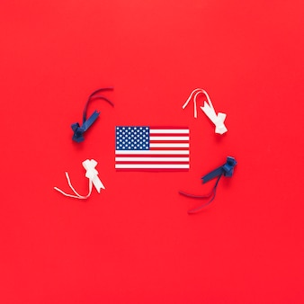 American flag with ribbons in red background