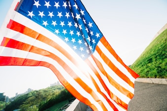 American flag with road and sunshine