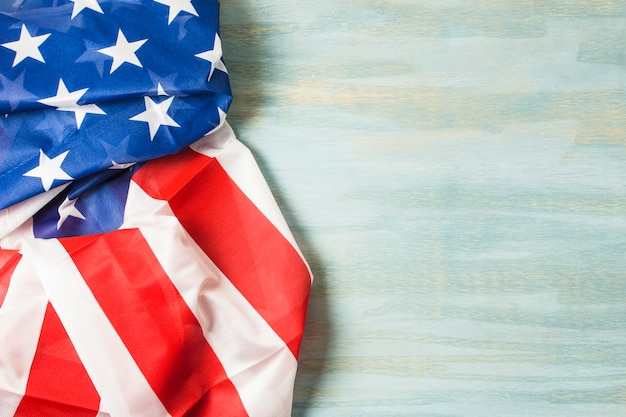 American flag on wooden textured backdrop
