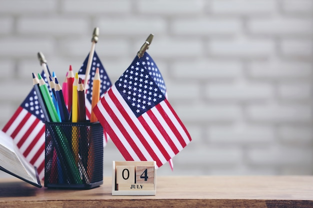 American flags and color pencils for independence day