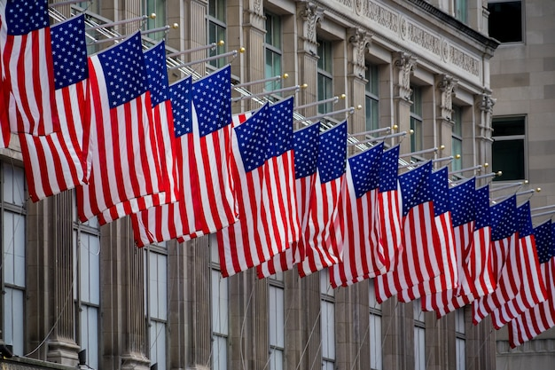 American flags hanging on the building in manhattan new york city