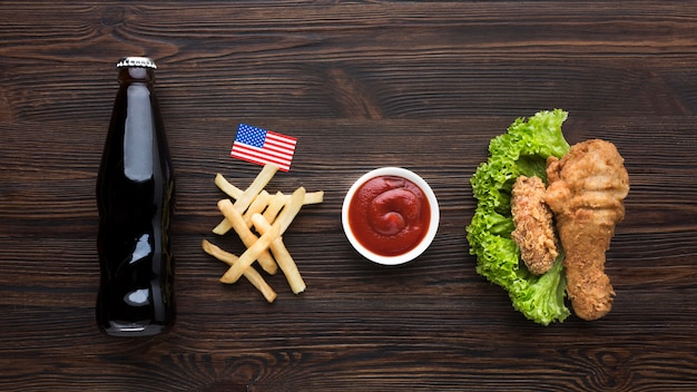 American food with soda bottle