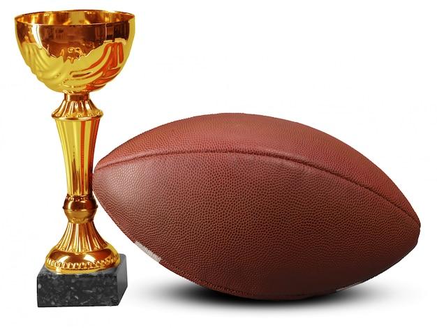 アメリカンフットボールのボールとトロフィー