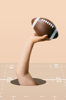 American football ball hold by a woman's hand on the brown background. sport and competition.3d illustration