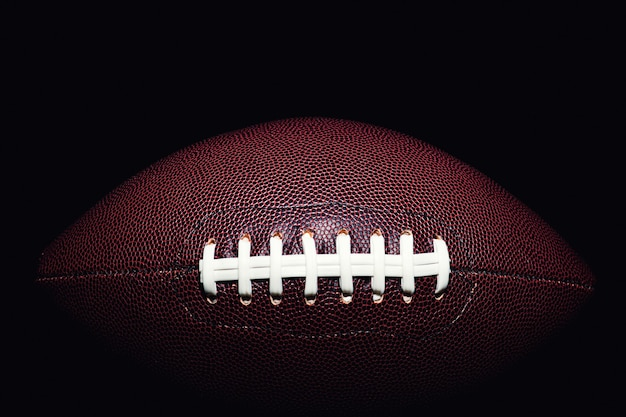 American football ball isolated on black