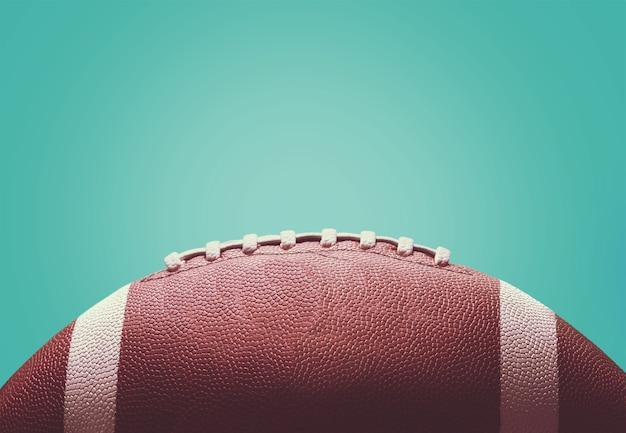 背景にアメリカンフットボールのボール