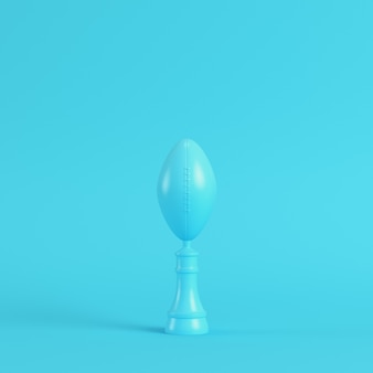 American football ball throphy on bright blue background in pastel colors