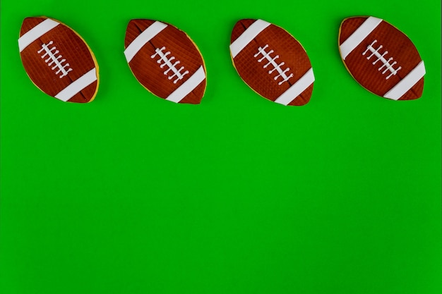 American football balls isolated on green background. top view.