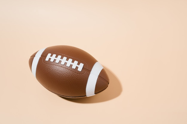 American football on brown background. sport and competition. copy space. 3d illustration