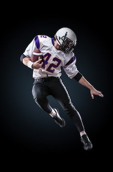 American football player in action. high jump of american football player