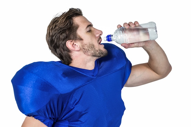 American football player drinking water