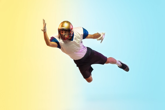 American football player on gradient studio in neon light