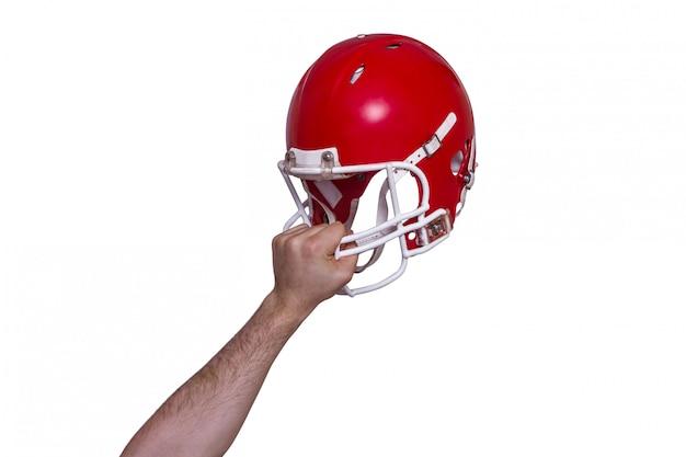 American football player handing his helmet