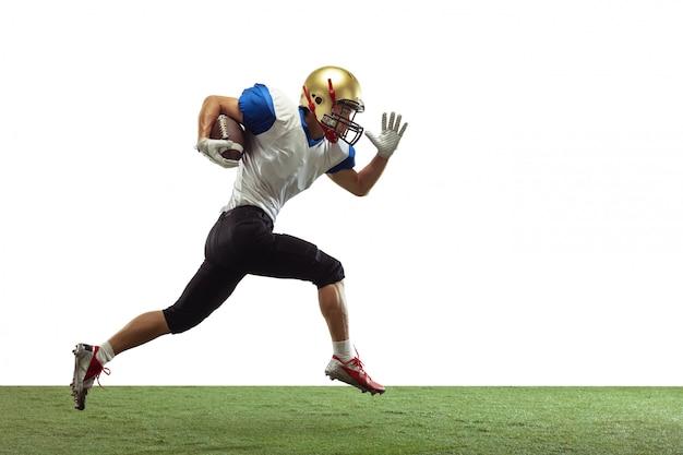 그림자와 네온 빛의 그라데이션 스튜디오 배경에 고립 된 미식 축구 선수