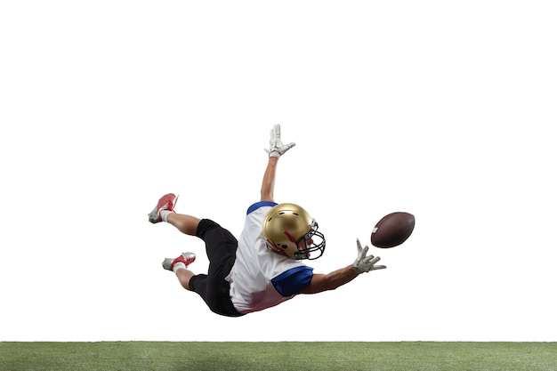 American football player isolated on white studio background with copyspace. professional sportsman during game playing in action and motion. concept of sport, movement, achievements.