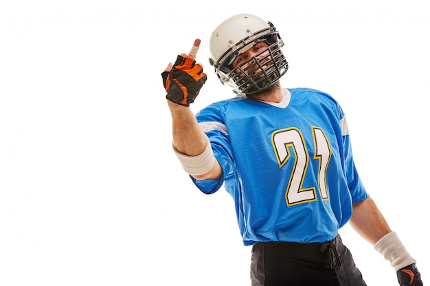 American football player in uniform shows middle finger