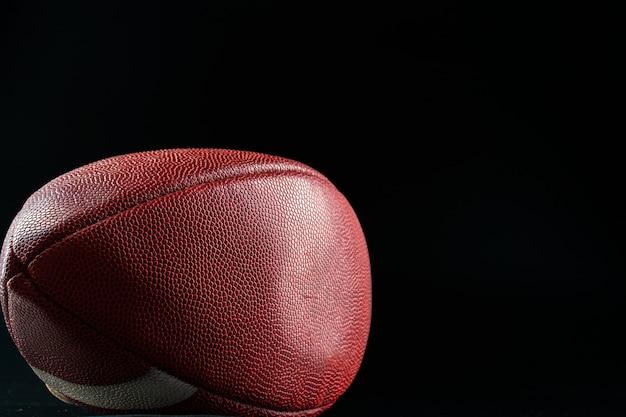 Американский футбольный мяч. концепция американского футбола