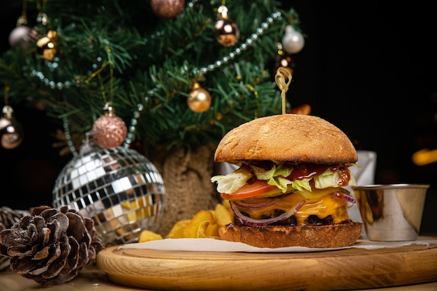 American hamburger, with sauce and french fries. until the new year and christmas