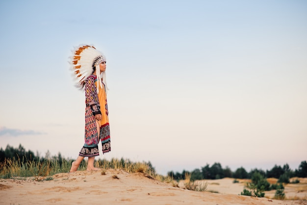American indian woman against mountain valley