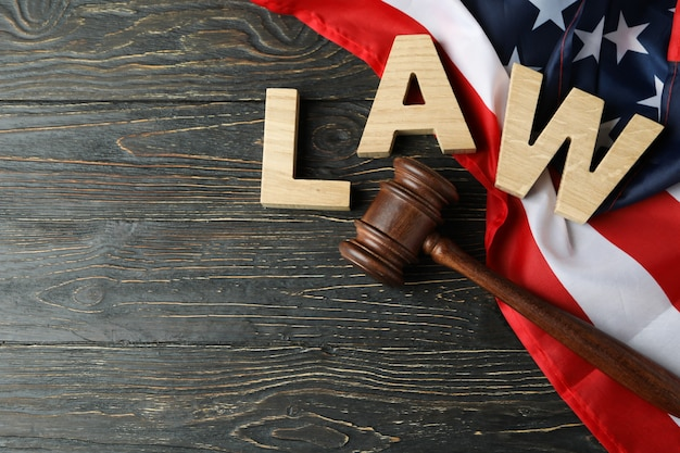 American law concept with judge gavel on wooden background