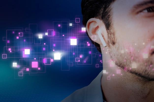 Uomo americano che ascolta musica con remix digitale di auricolari wireless