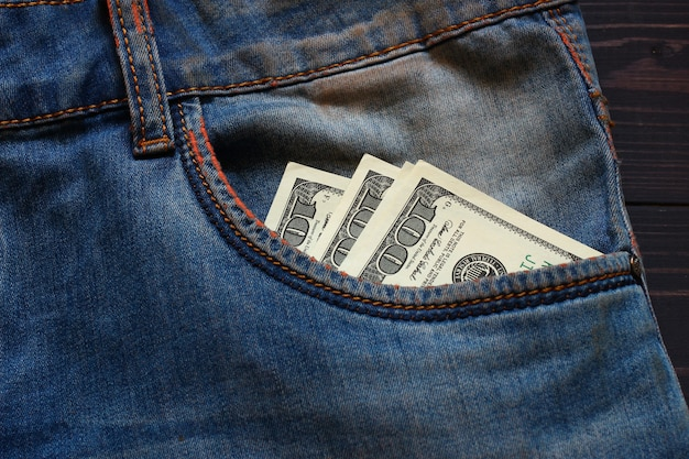 American money dollars in a pocket of trousers