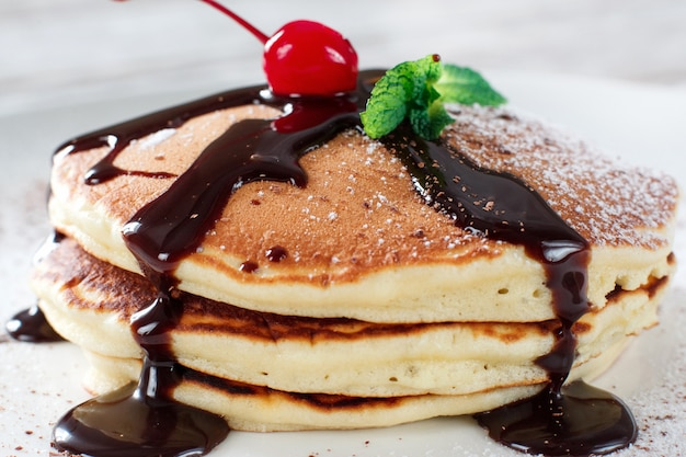 American pancakes with chocolate topping