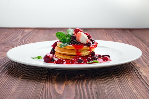 American pancakes with strawberry and black currant jam