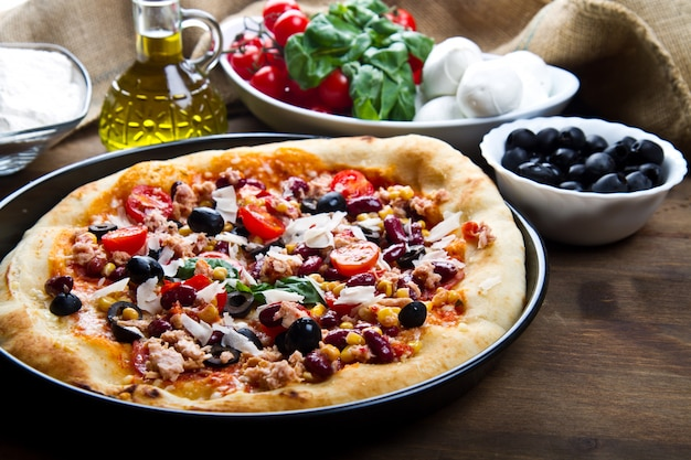 American pizza with tuna, red beans and mais