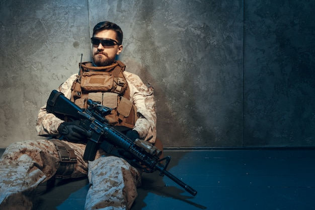 American private military contractor holding rifle.