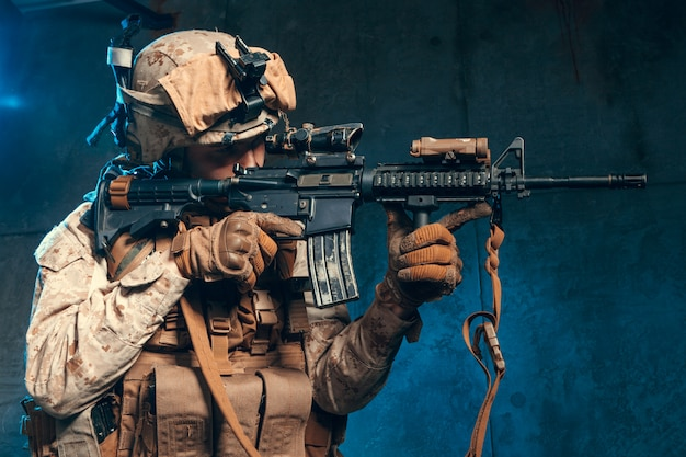American private military contractor shooting a rifle.