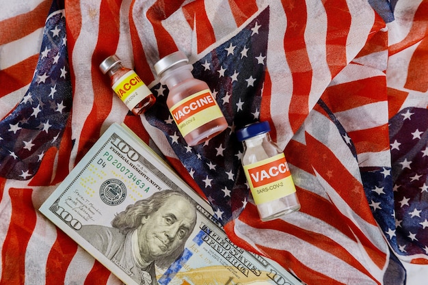American vaccine coronavirus sars-cov-2 covid-19 to fight in the coronavirus pandemic with the us dollar currency usa flag