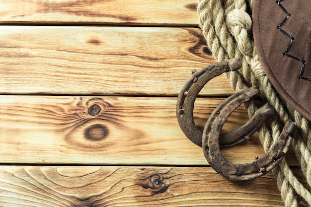 American west still life with old horse shoe background