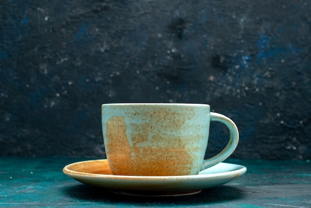 Americano with golden colour cup and saucer