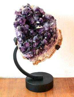 Amethyst mineral on a stand