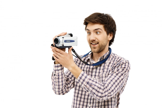Amused male blogger making video on camera