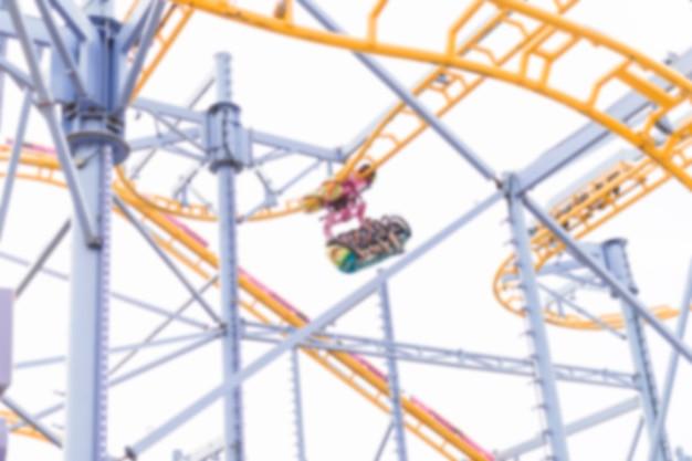 Amusement park composition with roller-coaster