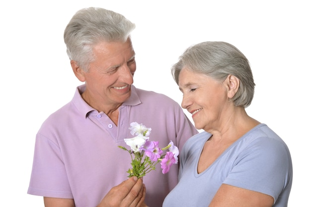 Amusing happy smiling old couple isolated on white background with flowers