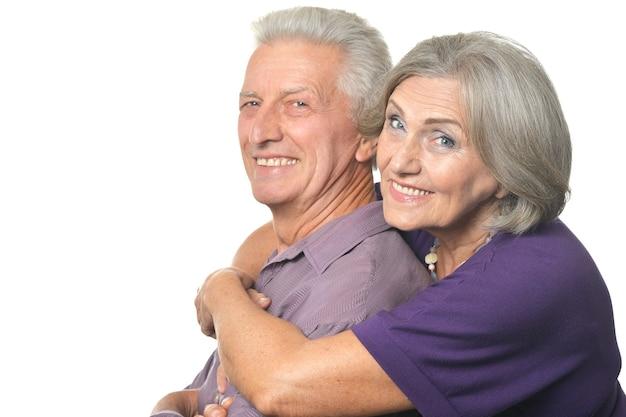 Amusing happy smiling old couple isolated on white background