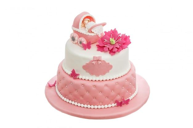 生まれたばかりの女の子のための洗礼のための素晴らしいケーキ。白い背景の上。