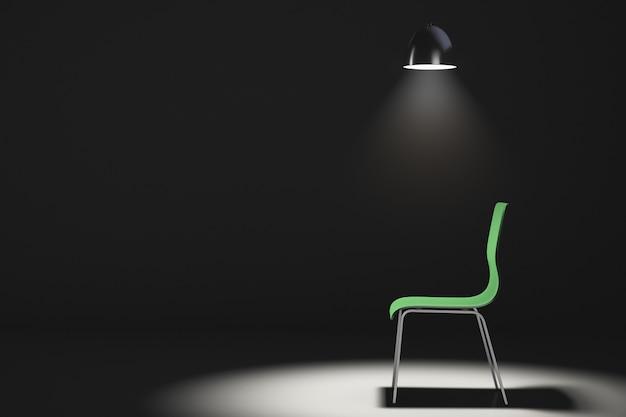 暗い部屋の空の椅子。椅子の上にランプをぶら下げ
