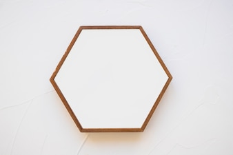 An empty hexagon frame against white background